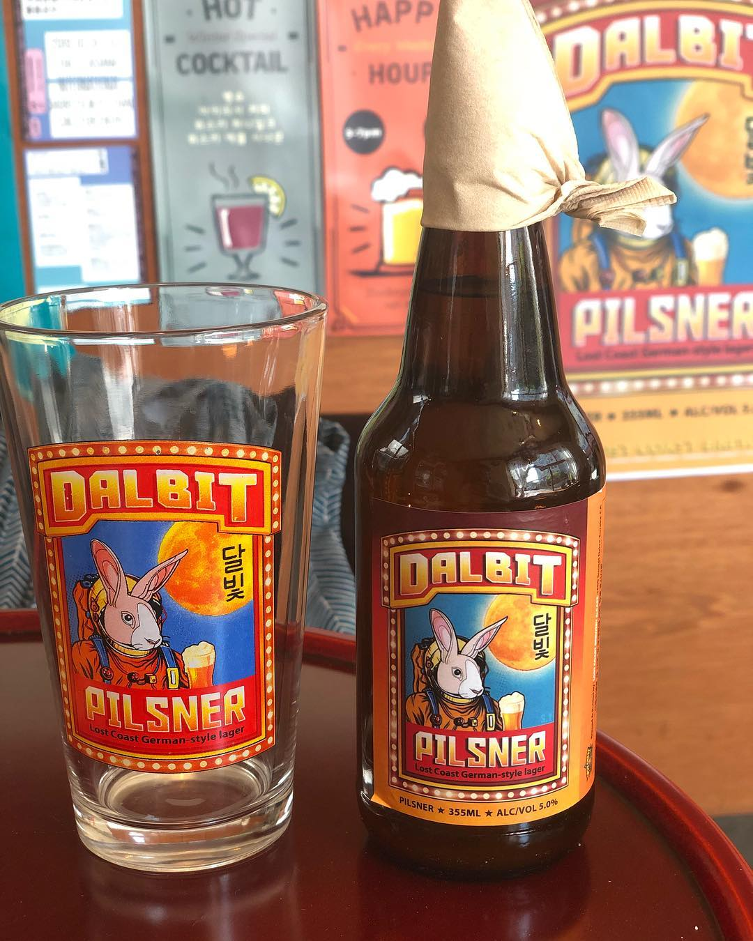 Yesterday I went to a bar that served a craft beer called Dalbit Pilsner.  This pilsner, made in the US exclusively for Korea, has (similar to Taiwanese Spring Vodka) also made its marketing correctly.  On the label you can see a rabbit wearing a space suit holding a beer. He is obviously traveling to the moon as depicted in the background. This is a nod to the moon rabbit that exist in certain folklores. I have written about this in previous posts.  The brewery behind this Rabbit pilsner is Lost Coast Brewery located in Eureka, California. The owner of the brewery is Barbara Groom, she is one of only a few prominent women in a traditionally male-dominated industry.  Before she became a brewery owner, Barbara was a pharmacist, I guess she swapped jobs with the astronaut rabbit who once he landed on the moon became the moon's own pharmacist.